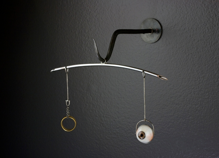"""Weights & Measures"" Mild steel, stainless, sterling, gold plate, synthetic eye ball (acrylic and glass) 14""w"